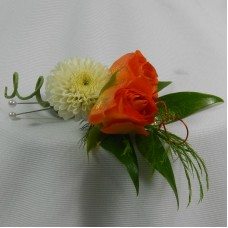 Boutonniere - Orange spray roses, white button pom